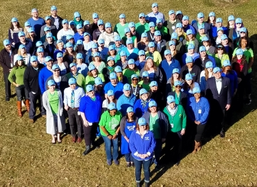 Gift of Life staff standing in heart shape on National Donate Life Blue & Green Day