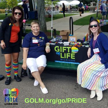 Volunteers at a Gift of Life Michigan booth at Jackson Pride
