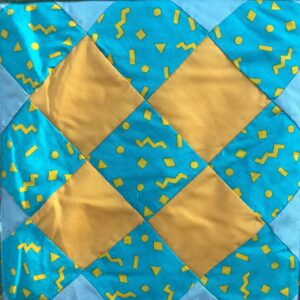 A blue and yellow quilted pattern