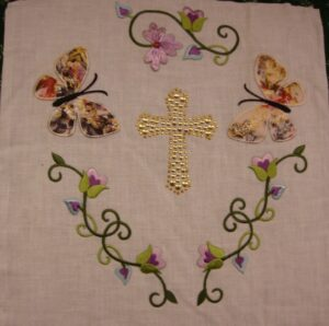Lois Busch/Hitchcock, A beautifully embroidered floral design around a cross