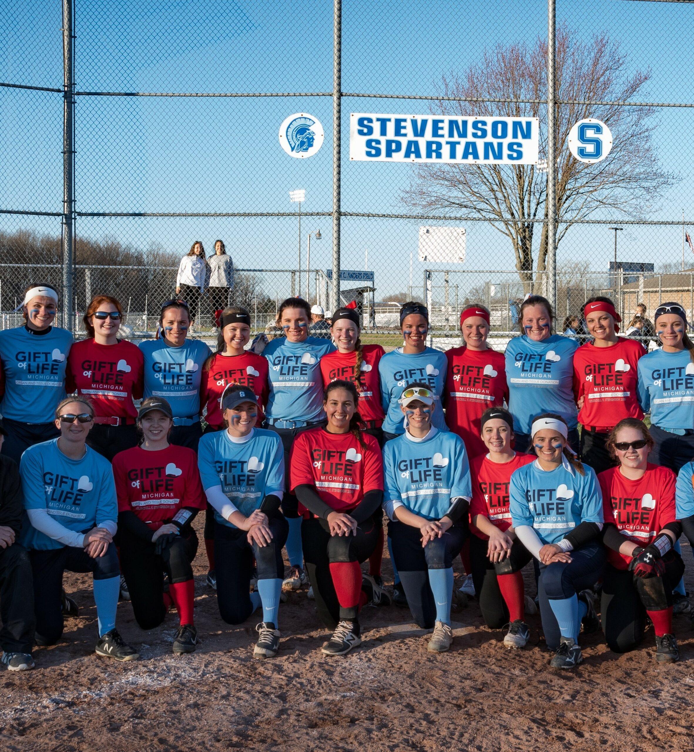 Group photo of two softball teams