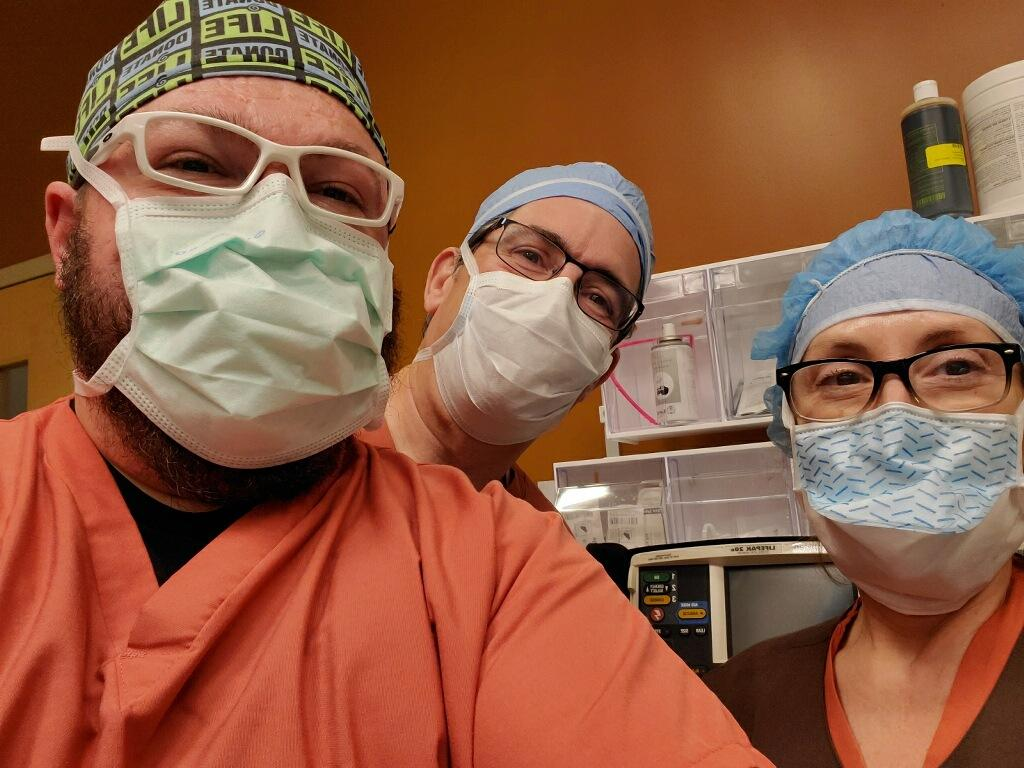 Donation Coordinators in scrubs and masks