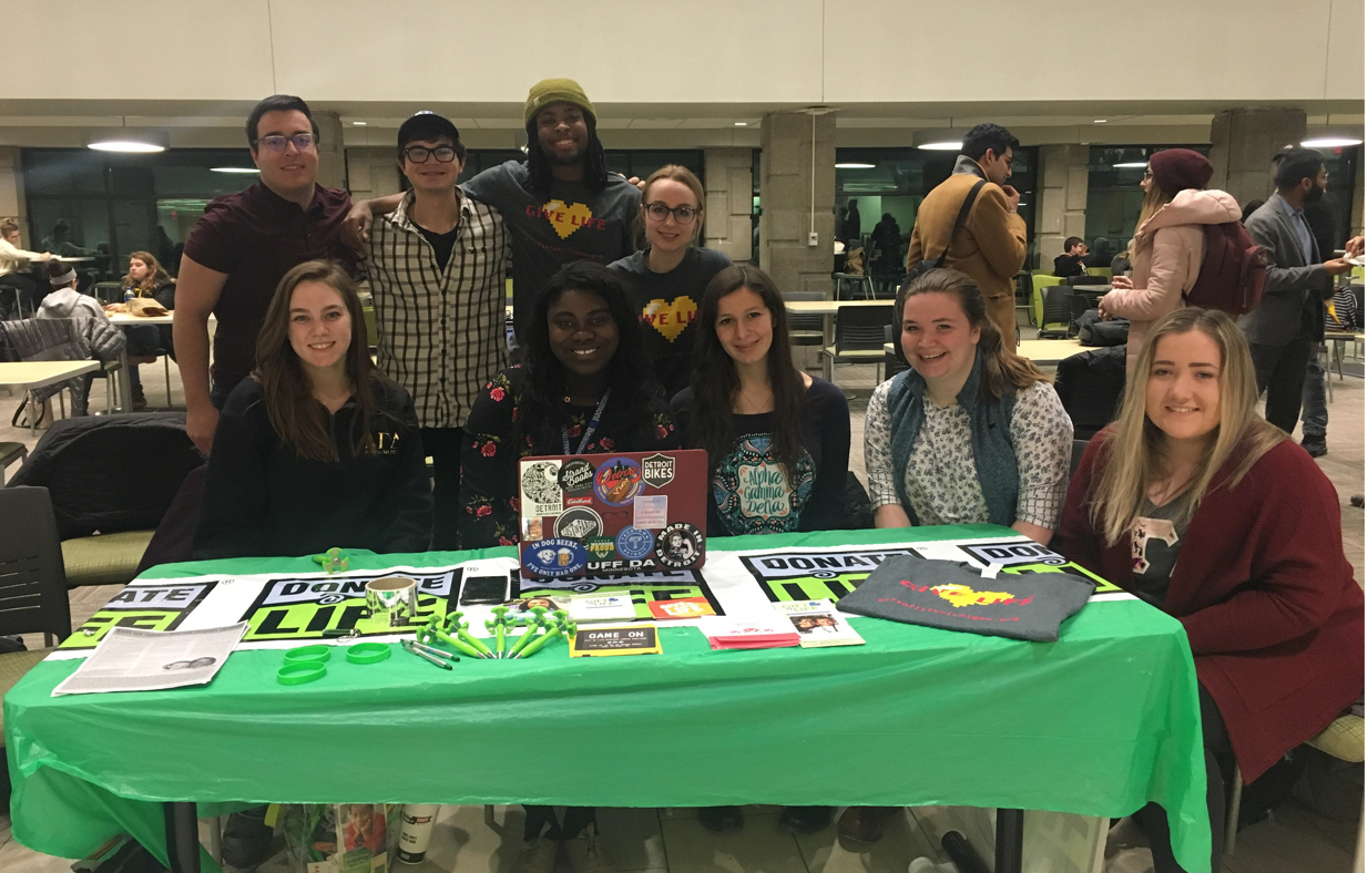 Group of college students at info table